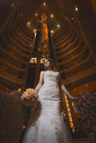 Happy bride in the modern hotel hall Stock Images