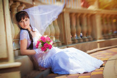 Happy bride near ancient columns Stock Image