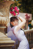 Happy bride near ancient flowerbed Royalty Free Stock Images