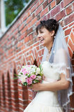Happy bride near ancient wall Royalty Free Stock Image