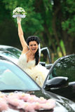 Happy bride near the car Royalty Free Stock Photo