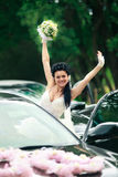 Happy bride near the car Royalty Free Stock Photos