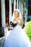 Happy Bride near luxury palace Stock Images