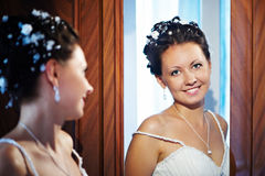 Happy bride near mirror Royalty Free Stock Images