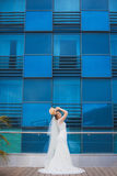 Happy bride with near the modern building. Royalty Free Stock Photography