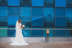 Happy bride with near the modern building. Stock Image