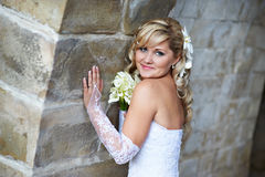 Happy bride near stone wall Stock Images
