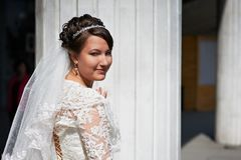 Happy bride near white columns Royalty Free Stock Image