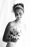 Happy bride near window Royalty Free Stock Photo