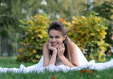 Happy bride in park Stock Image
