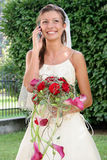 Happy Bride with phone Stock Photography