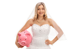 Happy bride with a piggybank Stock Images