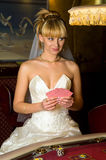 Happy bride playing cards Royalty Free Stock Photos