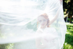 Happy bride poses for the photo. royalty free stock images