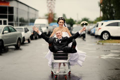 Happy bride pulling a fiance Stock Images