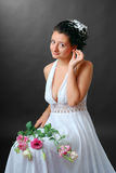 Happy bride readjusting an earring Stock Images
