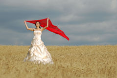 Happy bride with red cloth Royalty Free Stock Images