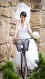 Happy bride riding a bike. Happy bride riding on a bike Royalty Free Stock Image