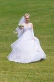 Happy bride runs to the groom Stock Photos