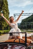 Happy bride screaming from classic convertible Stock Images