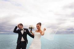 Happy bride on the sea quay. Stock Photos