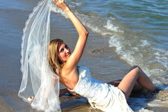 Happy bride of the sea - trash the dress Stock Image