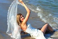 Happy bride of the sea - trash the dress stock image