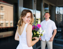 Happy bride and serious groom. Royalty Free Stock Image