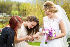 Happy bride showing wedding ring to bridesmaids Royalty Free Stock Photography