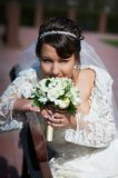 Happy bride sits on bench Stock Images