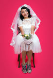 Happy bride sitting on a chair Royalty Free Stock Image
