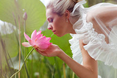 Happy bride smelling a lotus Stock Image