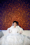 Happy bride on the sofa Royalty Free Stock Images
