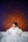 Happy bride on the sofa Royalty Free Stock Image