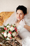 Happy bride on the sofa Stock Photography