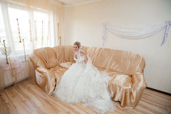 Happy bride on the sofa Royalty Free Stock Photos