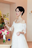 Happy Bride spraying perfume Stock Image