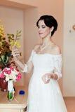 Happy Bride spraying perfume Royalty Free Stock Photography