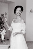 Happy Bride spraying perfume Stock Photo
