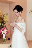 Happy Bride spraying perfume Royalty Free Stock Photo