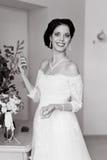 Happy Bride spraying perfume Royalty Free Stock Photos