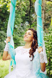 Happy bride on a swing Royalty Free Stock Photography
