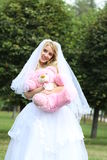 Happy bride with toy Royalty Free Stock Photos