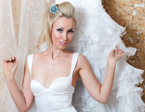 The happy bride tries on a wedding dress Royalty Free Stock Images