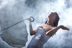 Happy bride with umbrella on big rain Stock Photo