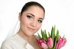 Happy bride with veil and tulips Royalty Free Stock Photos