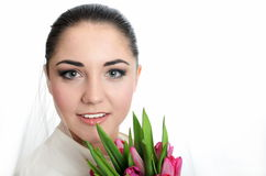 Happy bride with veil and tulips Royalty Free Stock Images