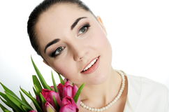 Happy bride with veil and tulips Stock Photography