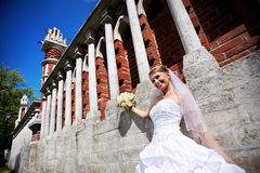 Happy Bride at wall to palace Stock Image