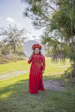 Happy bride wearing Vietnamese Ao Dai Stock Images